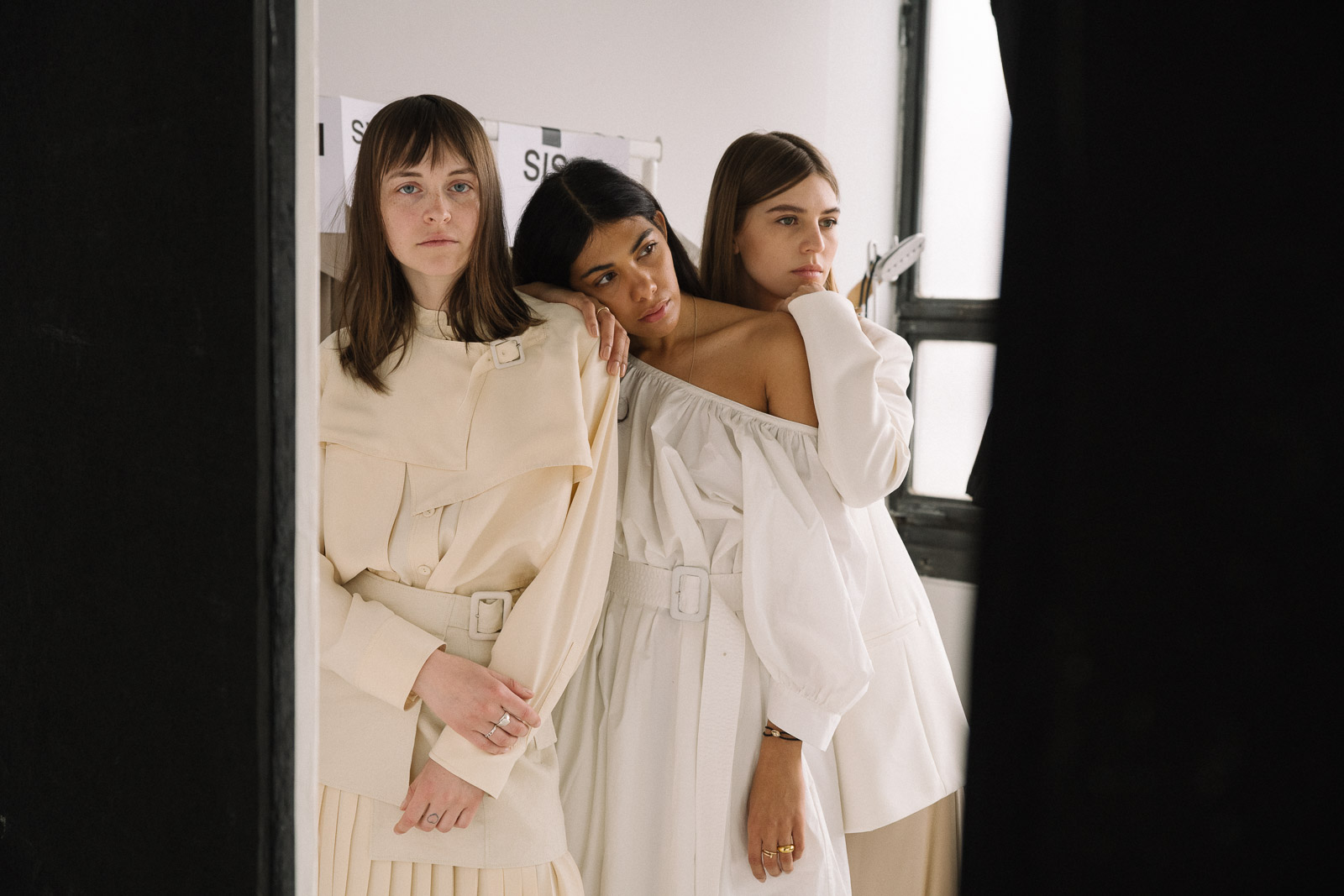 storm wears Joseph SS19 collection Shan Cotton Dress in white Sissi Pohle wears Tally Fuji Silk Blouse and Swantje Soemmer wears Claudia Suede Dress