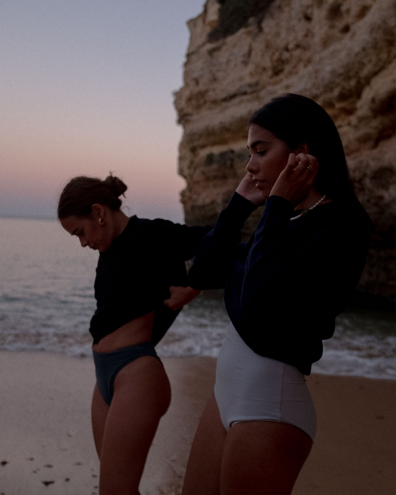 storm wears seidensticker sweater combined with blek swimsuits and desiree kastull wears black sweater shot by Marius Knieling in Portugal