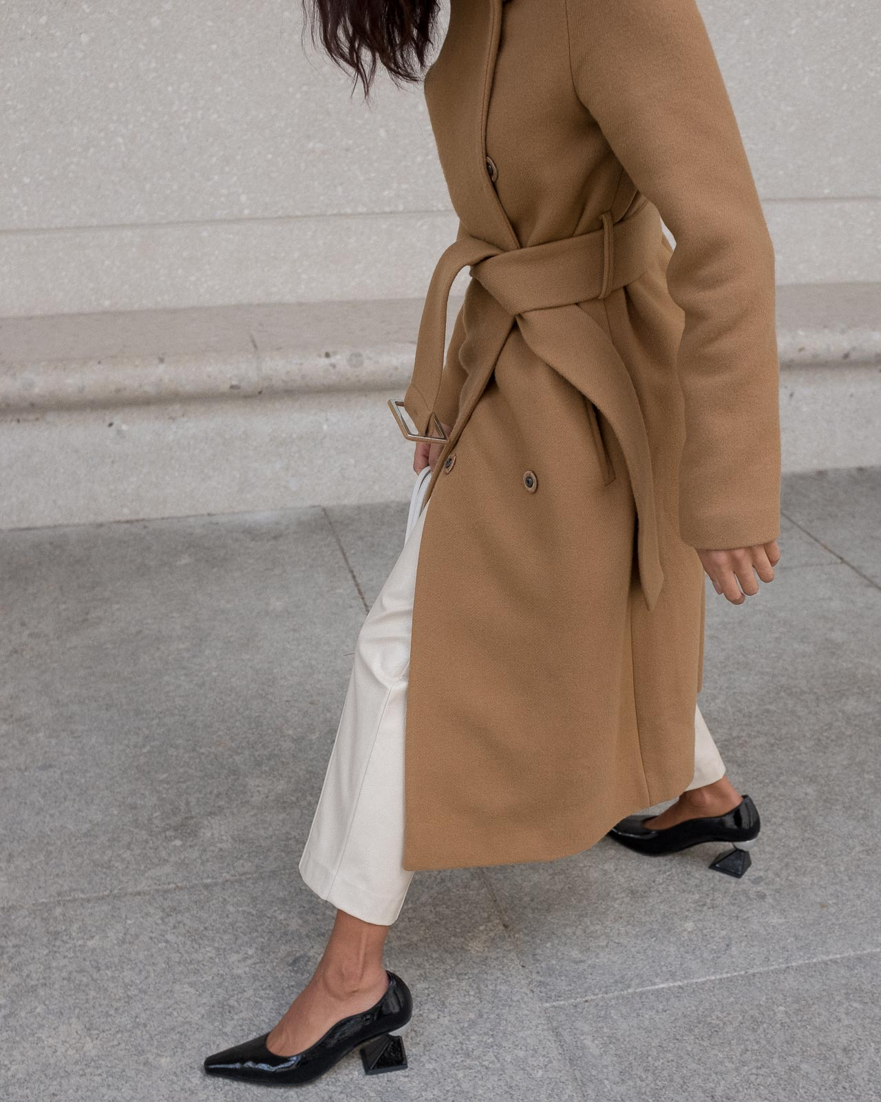 storm wears weekday creme pants combined with yuul yie black mules and by malene birger camel coat
