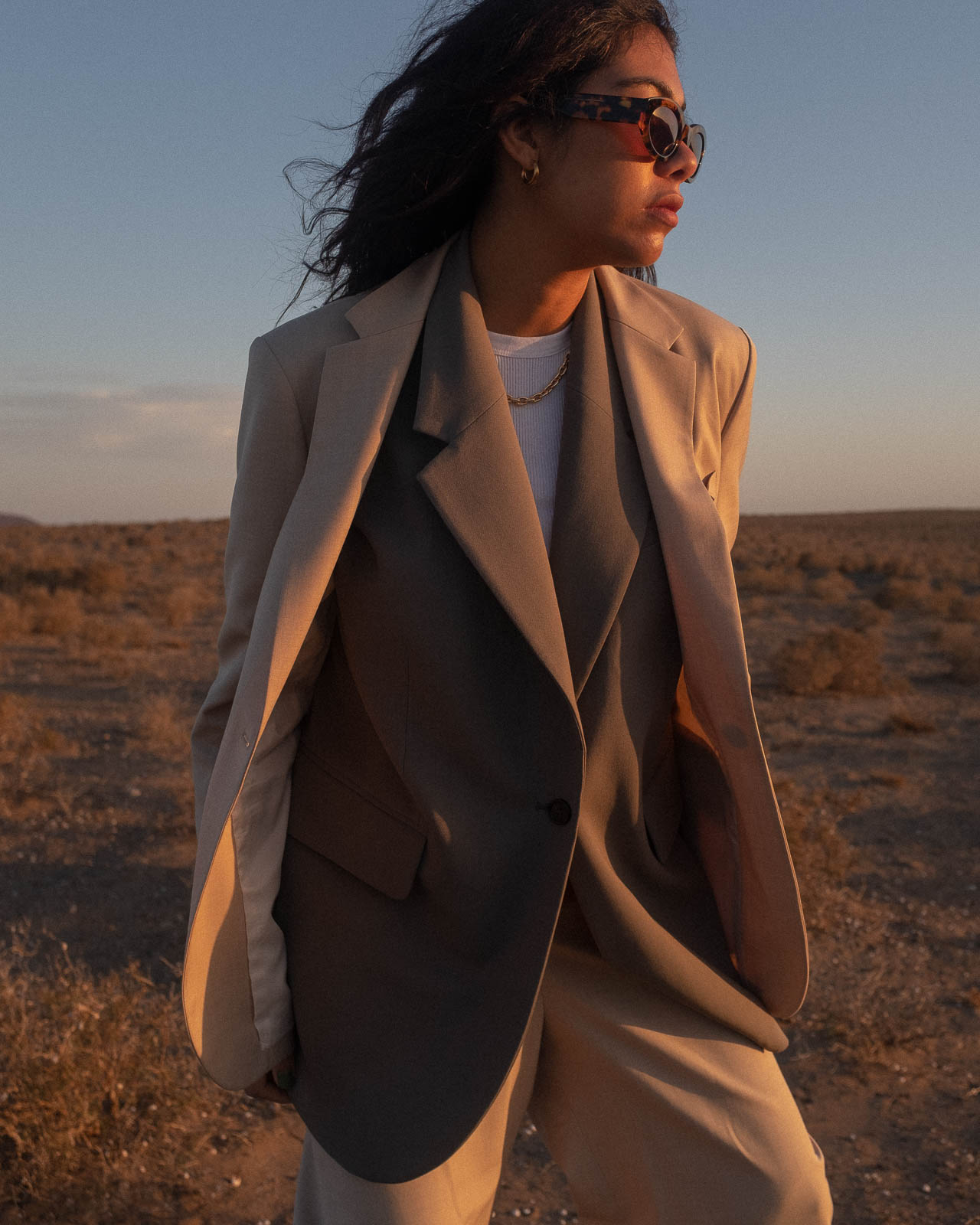 storm wears arket blazer in off grey combined with kindersalmon beige blazer and nina kastens chunky gold necklace in Lanzarote