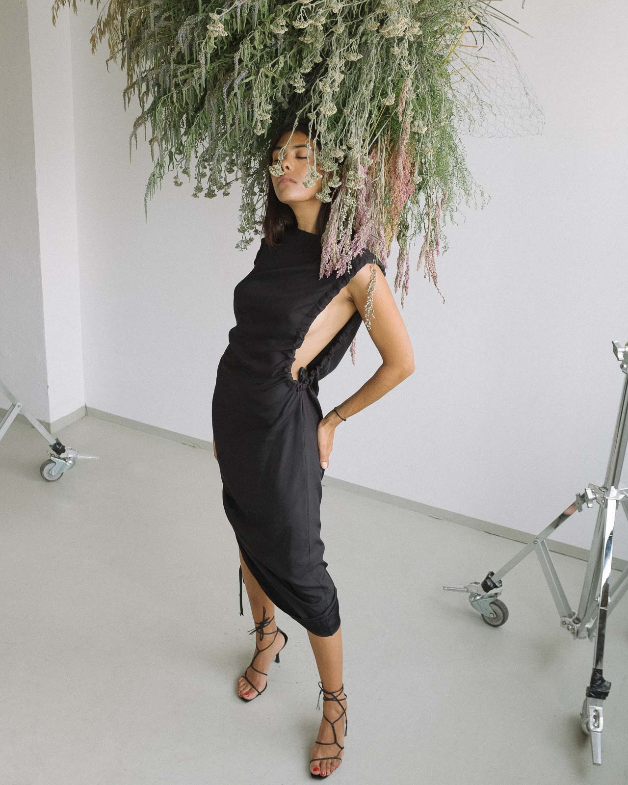 storm wears by malene birger black dress combined with gucci vintage sandals shot by marius knieling at studio230 flowers by studiolilo