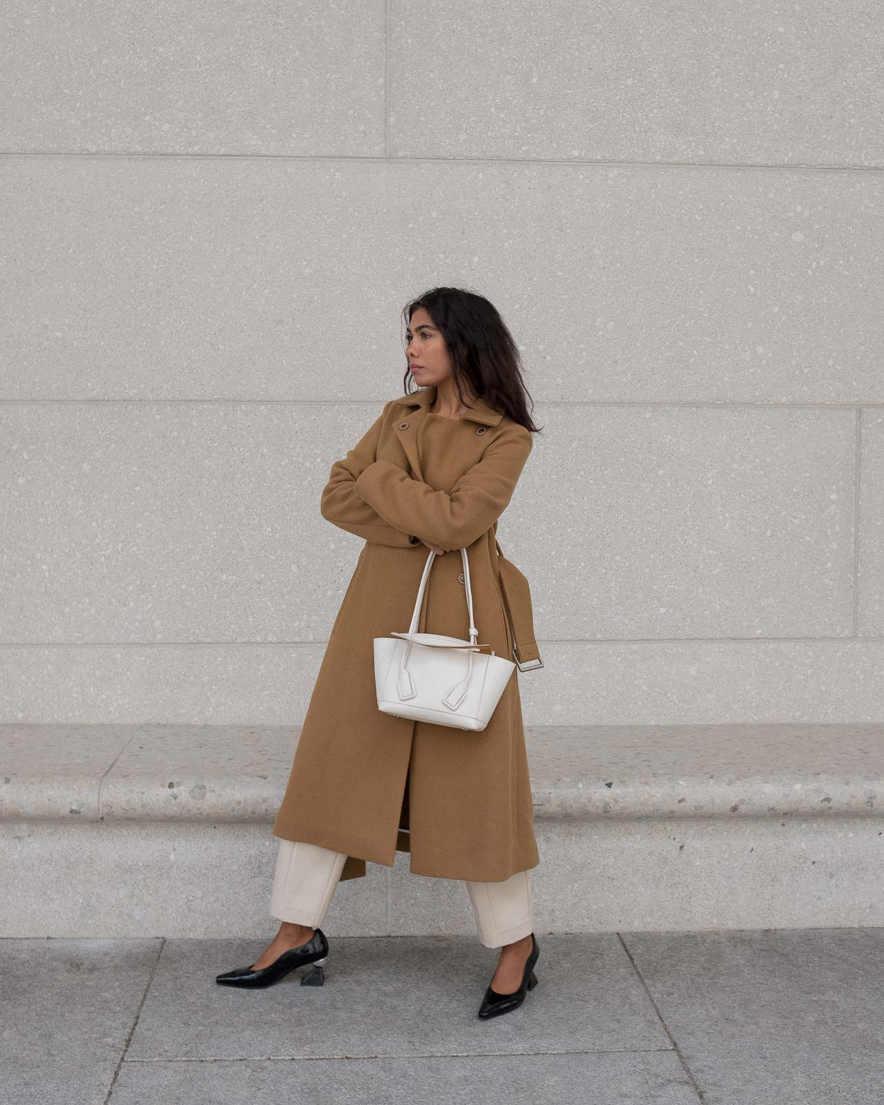 storm wears white bottega veneta arco bag with yuul yie black mules combined with by malene birger camel coat