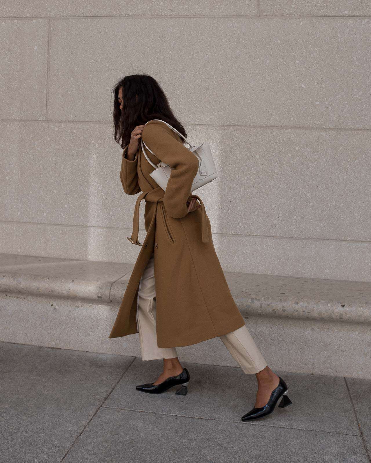 storm wears by malene birger camel coat combined with creme weekday pants and yuul yie black mules