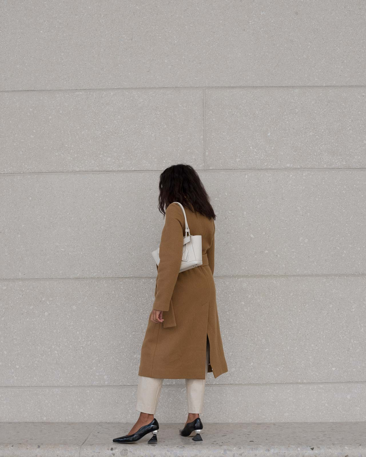 storm wears yuul yie black mules combined with camel coat from by malene birger